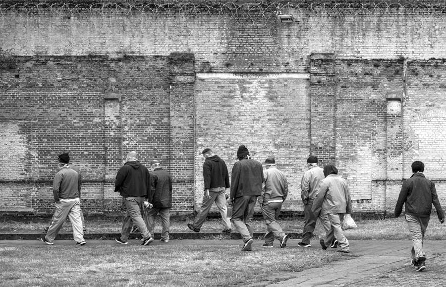 Inmates returning to their cells after a day's work in the Merksplas prison workhouses